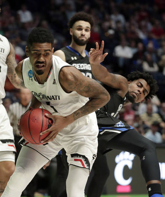 Cincinnati guard Jacob Evans (1) pulls in a rebound against Georgia State forward Jordan Session, right, in the second half of a first-round game of the NCAA college basketball tournament in Nashville, Tenn., Friday, March 16, 2018. (AP Photo/Mark Humphrey)