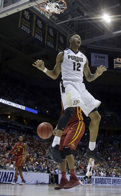 FILE - In this March 18, 2017, file photo, Purdue's Vince Edwards (12) reacts after dunking during the second half of an NCAA college basketball tournament second-round game against Iowa State, in Milwaukee. All the competition, the jawing, the instruction and the good-natured ribbing from his parents and siblings taught Edwards a lot about the game and helped him round into one of the most versatile players in the nation. (AP Photo/Morry Gash, File)
