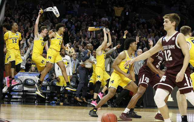 Michigan players celebrate during the second half of an NCAA men's college basketball tournament regional semifinal against Texas A&M on Thursday, March 22, 2018, in Los Angeles. (AP Photo/Alex Gallardo)