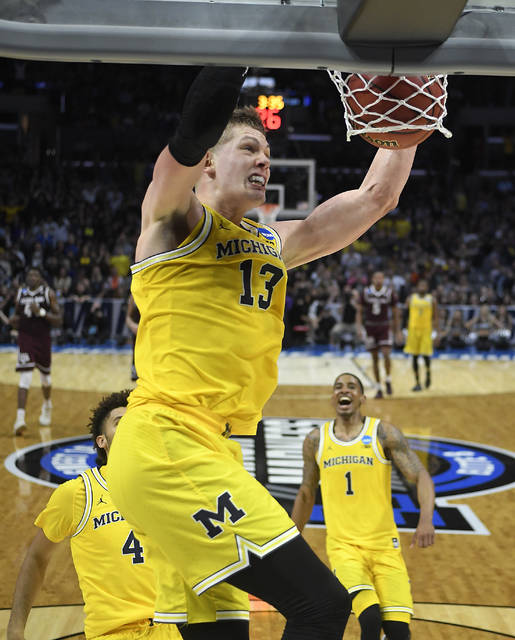 9f58dbd0769 Michigan forward Moritz Wagner (13) dunks against Texas A M during the  second half of an NCAA men s college basketball tournament regional  semifinal ...