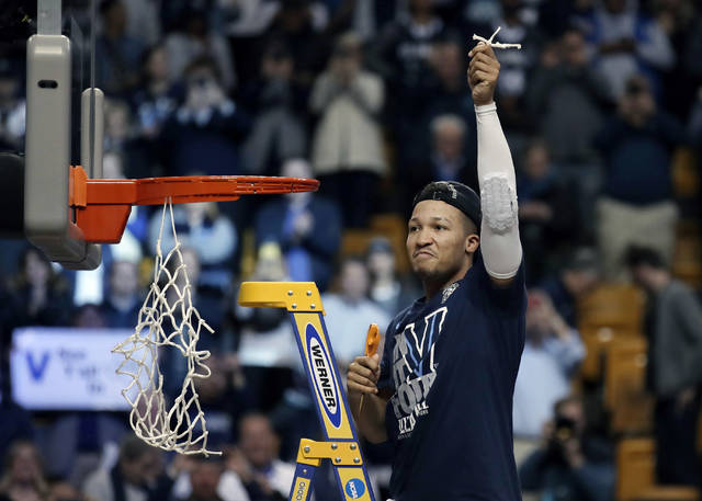 Villanova's Jalen Brunson celebrates after cutting a piece of net following the team's win over Texas Tech in an NCAA men's college basketball tournament regional final, Sunday, March 25, 2018, in Boston. Villanova won 71-59 to advance to the Final Four. (AP Photo/Charles Krupa)