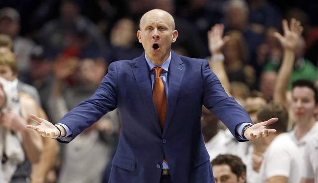 FILE - In this Dec. 30, 2017, fie photo, Xavier head coach Chris Mack reacts to a call during the second half of an NCAA college basketball game against DePaul in Cincinnati. According to multiple reports Louisville has hired Xavier's Chris Mack as its new men's basketball coach, hoping he can guide the program back to national contention after a turbulent season in which the Cardinals missed the NCAA Tournament. AP Photo/Gary Landers, File)