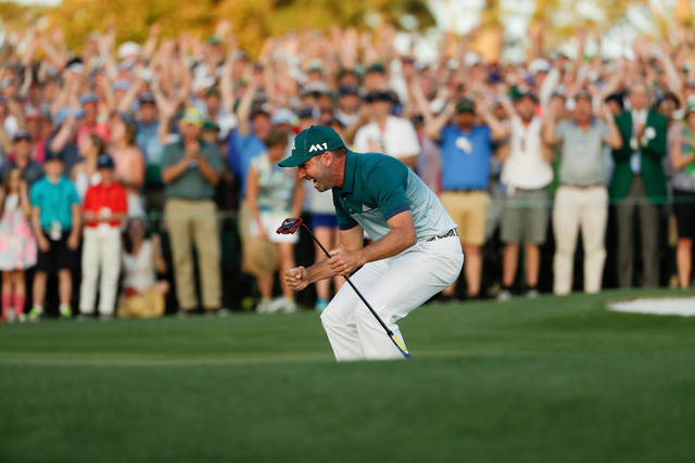 FILE - In this April 9, 2017, file photo, Sergio Garcia, of Spain, celebrates on the 18th hole after a playoff at the Masters golf tournament in Augusta, Ga. Garcia, the Masters champion, never felt any different from the Garcia who spent nearly 20 years trying to make sure his career would not be defined as the guy who never could win a major. He says he didn't changed as a person, and he was right. All the change took place before he won the Masters. (AP Photo/Matt Slocum, File)