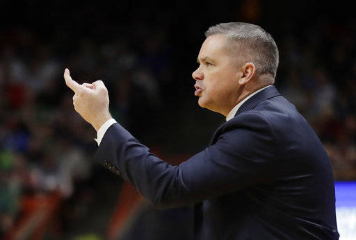 Ohio State head coach Chris Holtmann calls to his team during the second half of a second-round game against Gonzaga in the NCAA men's college basketball tournament Saturday, March 17, 2018, in Boise, Idaho. (AP Photo/Ted S. Warren)
