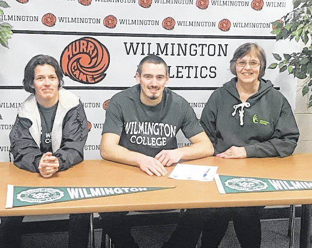 Wilmington High School senior Matt Smith plans to continue his academic and basketball careers at Wilmington College. In the photo, from left to right, Emily Gerhard, Matt Smith, Kathey Carroll.