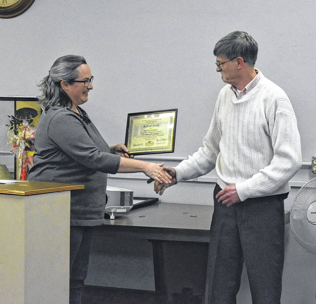 Richard Braley, right, accept his Tree Commission Academy certificate from Ohio Region 3 Forester Wendi Van Buren during Thursday's council meeting.