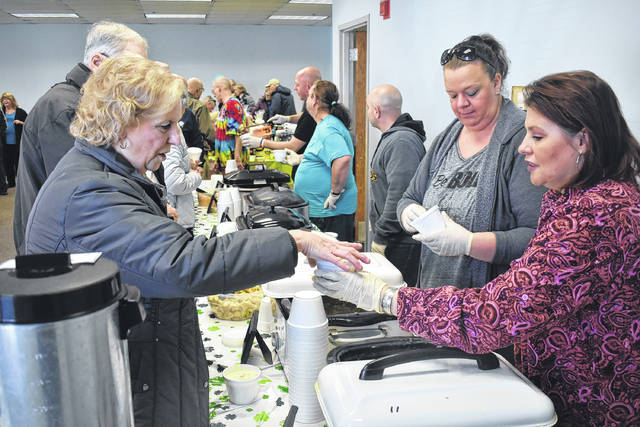 Peggy Hasdorff, left, gets a cup of soup from Homeless Shelter volunteer Candice Royer during the Clinton County Homeless Shelter's annual Soup & Chili Luncheon Fundraiser on Friday. The event featured five types of soup along with chili for a donation.