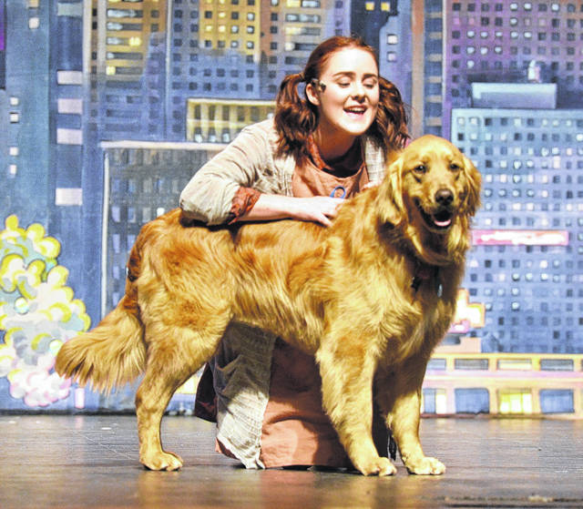 Samantha Burns as Annie, with Bo playing canine Sandy.