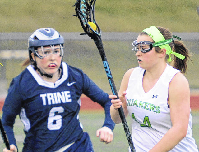 Becca Petra (14) had three goals to lead Wilmington to an 8-4 win over Earlham in women's lacrosse action.