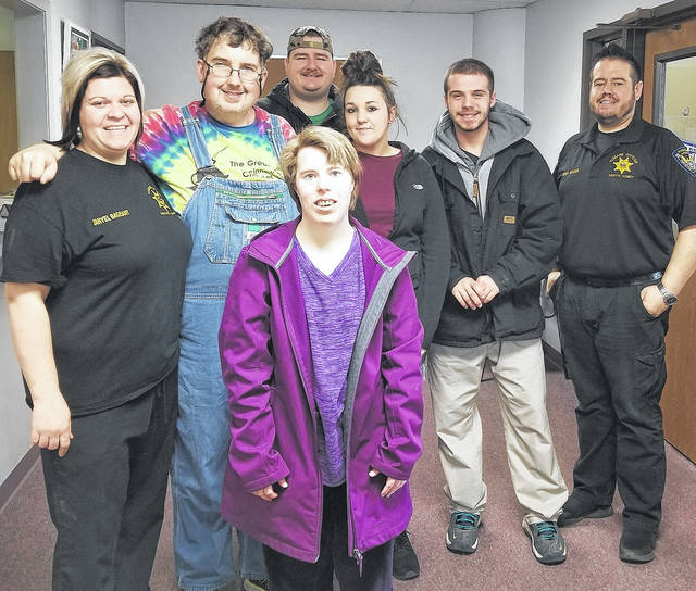 From left are: FRHS Humane Agent and Veterinary Technician Danyel Bageant; PCS group members Frank, Kelsey and Andy; PCS rep Emily Wisecup; PCS member Austin; and FRHS Outreach Director and Humane Agent Brad Adams.