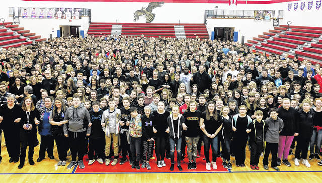 CM high school and middle school students and staff stand united, arm-in-arm against school violence.