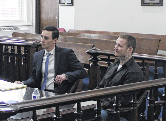 Gerald Jackson Jr., right, sits in court with defense attorney Adam King during a jury trial on Thursday.