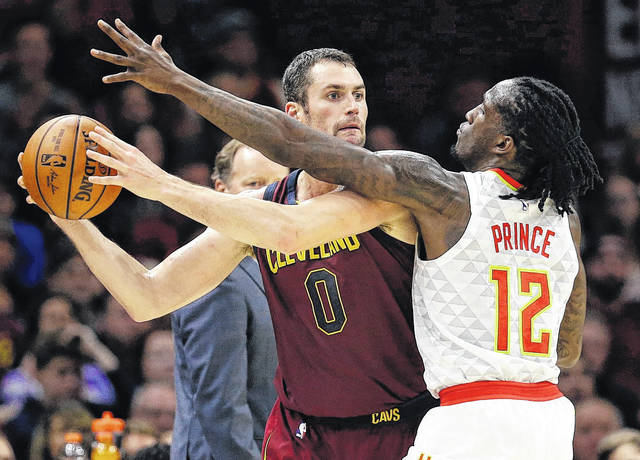 In this Nov. 5, 2017, file photo, Cleveland Cavaliers' Kevin Love (0) looks to pass against Atlanta Hawks' Taurean Prince (12) in the first half of an NBA basketball game in Cleveland. Love disclosed in an essay for the Players' Tribune on Tuesday, March 6, 2018, that he suffered a panic attack on Nov. 5 in a home game against the Hawks. (AP Photo/Tony Dejak, File)