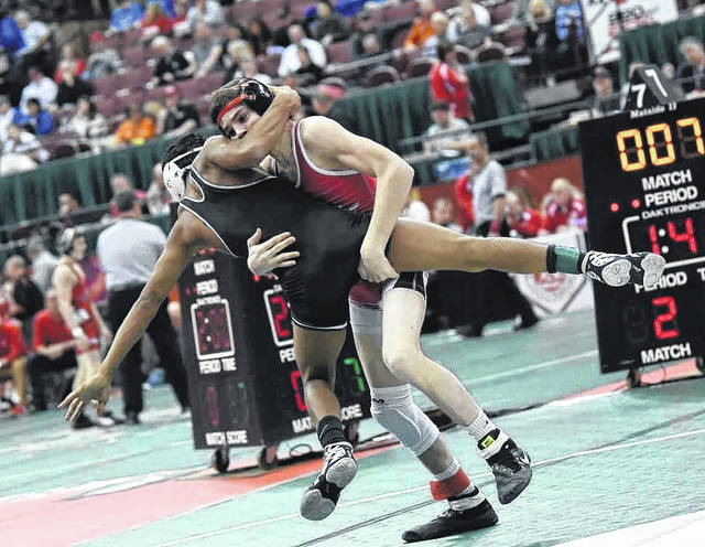 East Clinton's Wyatt Riddle dominated Sarahsville Shenandoah's Alex Overly in the Division III 106 class to move on to the quarterfinals.