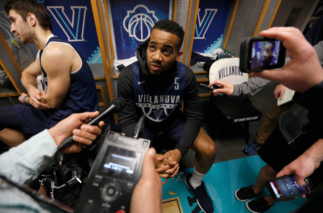 Villanova's Phil Booth answers questions during a news conference for the championship game of the Final Four NCAA college basketball tournament, Sunday, April 1, 2018, in San Antonio. (AP Photo/Charlie Neibergall)