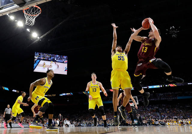 Loyola-Chicago guard Clayton Custer (13) shoots over Michigan guard Eli Brooks (55) during the first half in the semifinals of the Final Four NCAA college basketball tournament, Saturday, March 31, 2018, in San Antonio. (AP Photo/David J. Phillip)