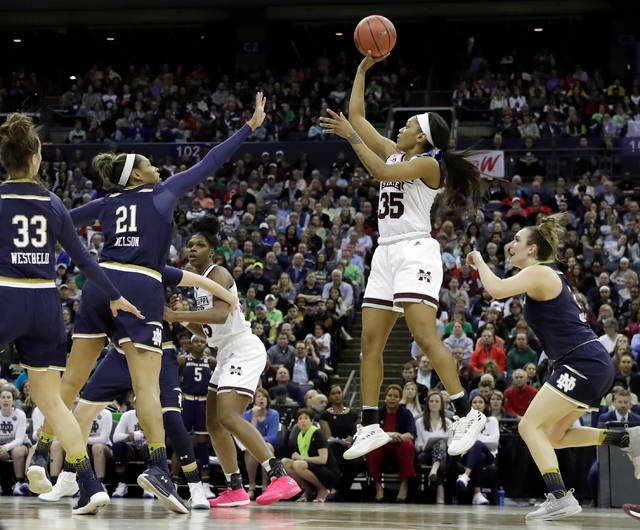 Mississippi State's Victoria Vivians (35) shoots over Notre Dame defenders during the first half in the final of the women's NCAA Final Four college basketball tournament, Sunday, April 1, 2018, in Columbus, Ohio. (AP Photo/Darron Cummings)