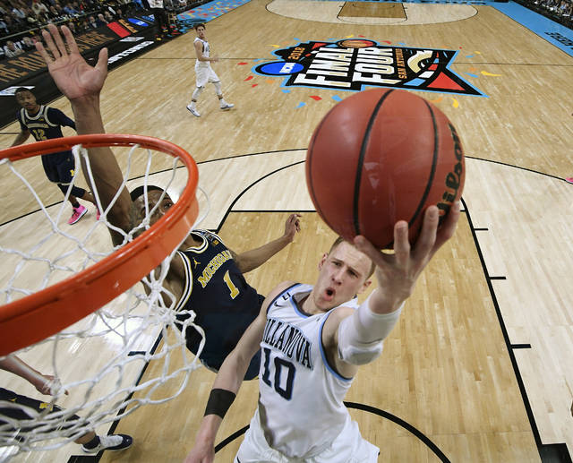 Villanova's Donte DiVincenzo (10) goes up for a shot past Michigan's Charles Matthews (1) during the second half in the championship game of the Final Four NCAA college basketball tournament, Monday, April 2, 2018, in San Antonio. (AP Photo/Chris Steppig, NCAA Photos Pool)