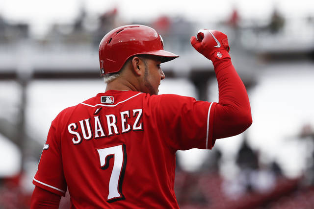 Cincinnati Reds' Eugenio Suarez reacts after hitting a triple off Chicago Cubs starting pitcher Tyler Chatwood in the fourth inning of a baseball game, Monday, April 2, 2018, in Cincinnati. (AP Photo/John Minchillo)