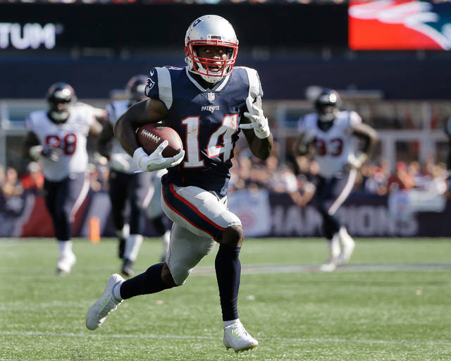 FILE - In this Sept. 24, 2017, file photo, New England Patriots wide receiver Brandin Cooks runs toward the goal line for a touchdown after catching a pass from Tom Brady during the second half of an NFL football game against the Houston Texans in Foxborough, Mass. The Patriots have traded Cooks to the Rams for Los Angeles' first-round draft pick, 23rd overall. In the deal Tuesday, April 3, 2018, New England also sends a fourth-round choice to the Rams, who give the Patriots a sixth-rounder. (AP Photo/Steven Senne, File)