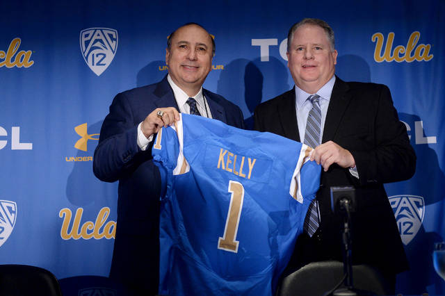 FILE - In this Monday, Nov. 27, 2017, file photo, new UCLA head football coach Chip Kelly, right, and director of athletics Dan Guerrero pose for a photo during a news conference on the UCLA campus at Pauley Pavilion, in Los Angeles. At least one rankings list has Kelly as one of the coaches most likely to succeed in 2018. (Hans Gutknecht/Los Angeles Daily News via AP, File)