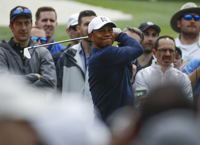 Tiger Woods hits from the third tee during a practice round for the Masters golf tournament Wednesday, April 4, 2018, in Augusta, Ga. (AP Photo/Chris Carlson)