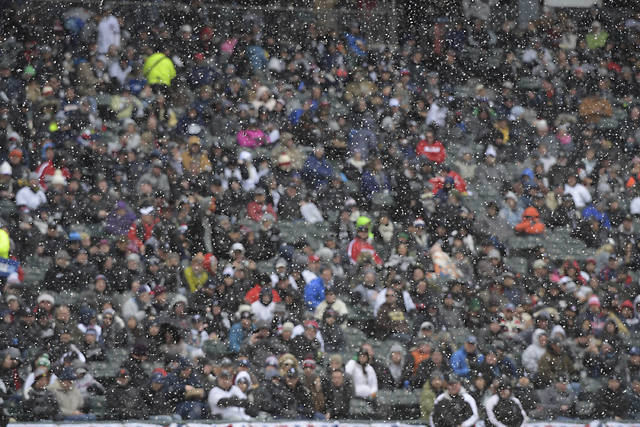 Snow falls during a baseball game between the Detroit Tigers and the Chicago White Sox on Thursday, April 5, 2018, in Chicago. The Tigers won 9-7. (John Starks/Daily Herald via AP)