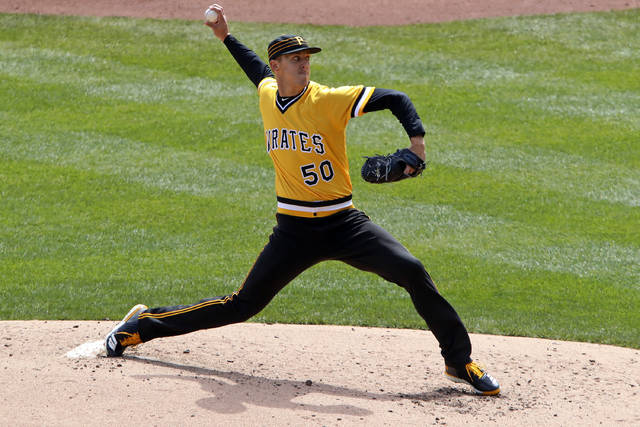 Pittsburgh Pirates starting pitcher Jameson Taillon delivers in the fifth inning of the team's baseball game against the Cincinnati Reds in Pittsburgh, Sunday, April 8, 2018. Taillon threw a complete game, one-hit shutout with the Pirates winning 5-0. (AP Photo/Gene J. Puskar)