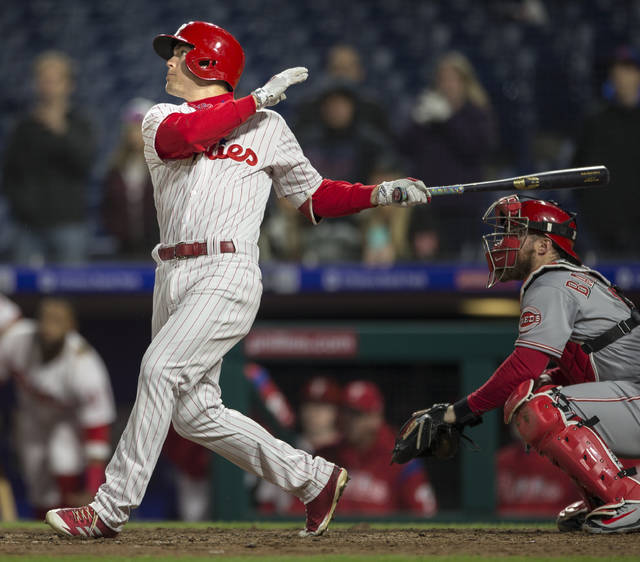 Philadelphia Phillies' Scott Kingery watches his RBI sacrifice fly in the 12th inning of a baseball game against the Cincinnati Reds, Wednesday, April 11, 2018, in Philadelphia. The Phillies won 4-3. (AP Photo/Laurence Kesterson)