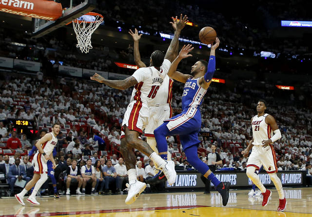 Philadelphia 76ers guard Ben Simmons (25) shoots in the first quarter as Miami Heat forward James Johnson (16) defends in Game 4 of a first-round NBA basketball playoff series, Saturday, April 21, 2018, in Miami. (AP Photo/Joe Skipper)