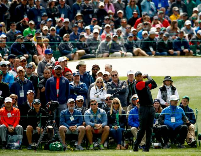 FILE - In this April 8, 2018, file photo, Tiger Woods hits a drive on the third hole during the fourth round at the Masters golf tournament in Augusta, Ga. Woods brought back the largest crowds to golf with his return from back surgery. (AP Photo/Charlie Riedel, File)
