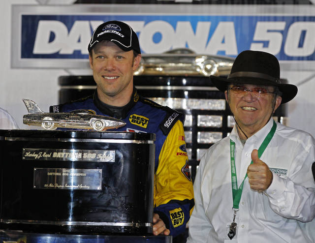 FILE - In this Feb. 28, 2012, file photo, driver Matt Kenseth, left, and car owner Jack Roush celebrate in victory lane after Kenseth won the NASCAR Daytona 500 auto race at Daytona International Speedway in Daytona Beach, Fla. Kenseth will return to NASCAR this season in a reunion with Roush Fenway Racing, the team that gave him his Cup start in 1998. Kenseth will split the No. 6 Ford with Trevor Bayne, who has been the full-time driver of that car since 2015. Kenseth has sponsorship from Wyndham Hotels & Resorts, and his return will come next month at Kansas Speedway. Roush did not announce Wednesday, April 25, 2018, how many races Kenseth will drive. (AP Photo/Terry Renna, File)