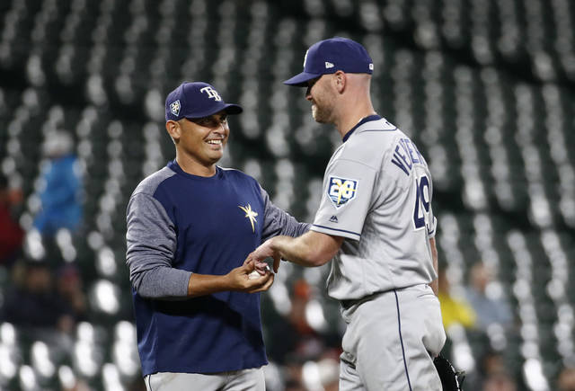Tampa Bay Rays manager Kevin Cash, left, removes relief pitcher Jonny Venters during the sixth inning of the team's baseball game against the Baltimore Orioles, Wednesday, April 25, 2018, in Baltimore. (AP Photo/Patrick Semansky)
