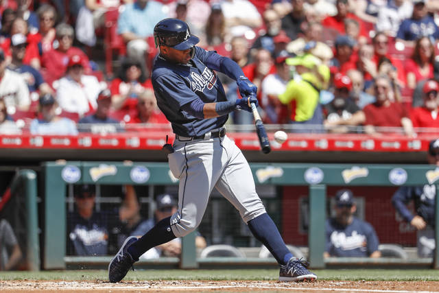 Atlanta Braves' Ronald Acuna Jr. hits a solo home run off Cincinnati Reds starting pitcher Homer Bailey in the second inning of a baseball game, Thursday, April 26, 2018, in Cincinnati. Acuna recorded his second major league hit overall and his first home run. (AP Photo/John Minchillo)