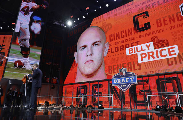 Commissioner Roger Goodell, left, poses with a fan after the Cincinnati Bengals selected Billy Price during the first round of the NFL football draft, Thursday, April 26, 2018, in Arlington, Texas. (AP Photo/David J. Phillip)