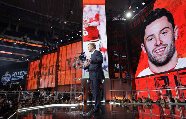 Commissioner Roger Goodell speaks at the podium after the Cleveland Browns selected Oklahoma's Baker Mayfield as their pick during the first round of the NFL football draft, Thursday, April 26, 2018, in Arlington, Texas. (AP Photo/David J. Phillip)