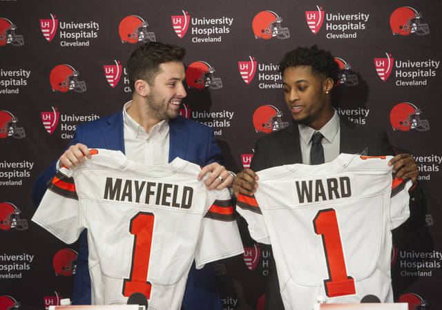 Cleveland Browns first-round draftees Baker Mayfield, left, and Denzel Ward pose after a news conference at the team's headquarters in Berea, Ohio, Friday, April 27, 2018. (AP Photo/Phil Long)