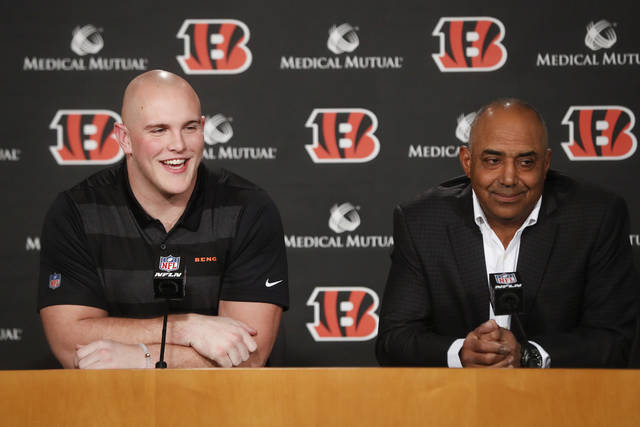 Cincinnati Bengals first-round NFL football draft pick Billy Price, left, speaks alongside head coach Marvin Lewis, right, during a news conference at Paul Brown Stadium, Friday, April 27, 2018, in Cincinnati. (AP Photo/John Minchillo)