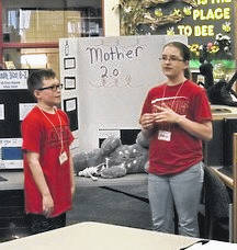 """East Clinton Middle School students Seth Rowley and Madison Frazer present their """"Invention Convention"""" project to the school board."""