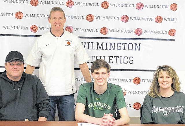 Wilmington High School senior Layne Griffith will attend Wilmington College and plans to play basketball for the Quakers. In the photo, from left to right, front row, father Todd Griffith, Layne Griffith, mother Amy Griffith; back row, WHS varsity boys basketball coach Michael Noszka.