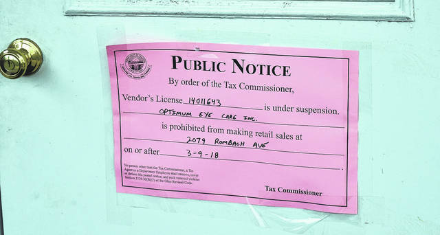 This sign was posted on the front door of Optimum Eyecare in early March by the Ohio Department of Taxation.