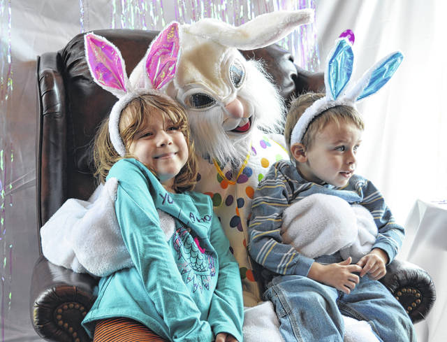 From left Addie Deemer, 6, and Logan Johnson, 2, are pleased to make the acquaintance of the Easter Bunny at a Saturday event at the Snow Hill Country Club north of New Vienna. The occasion was well-attended.