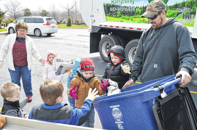 Youngsters at the Presbyterian Church of Wilmington Timber Faith Preschool enjoyed learning to recycle as the City of Wilmington's Justin Smith, with help from son Wayde, stopped by with the recycling truck Tuesday. Kids that joined in the fun also included Grant, K.J., Bennie, John and Zoey, along with teachers Miss Sara and Miss Janis. For more photos of the event, visit wnewsj.com. The city recently announced that, due to customer demand, the Sanitation Department is now picking up curbside recyclables every week in response to a nearly 150 percent increase in recyclables by residents since implementation of the program March 1.