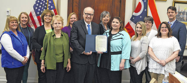 Clinton County commissioners Wednesday recognize the month of April 2018 as Sexual Assault Awareness Month. Altneratives to Violence Center's staff and volunteers join commissioners for the proclamation. From left in the front row are Commissioner Brenda K. Woods, Joan Burge, Commissioners President Patrick Haley, Julie Brassel, Cassy Gault and Chanda Valentine; and from left in the back row are Kimberly Newman, Tammy Speelman, Dawn Shumaker, Ginny Thompson, Becky Boris and Commissioner Kerry R. Steed.