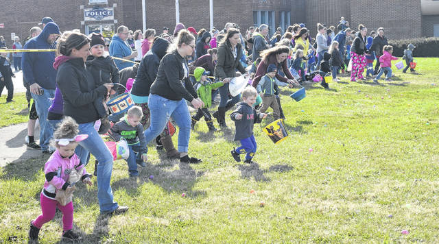 Kids and parents rush onto the field to get their Easter goodies during the Blanchester Parks and Recreation Easter Egg Hunt on Saturday at the village Municipal Building.