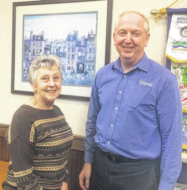 Kay Fisher of the Clinton County History Center with Wilmington Rotary President Bob Schaad.