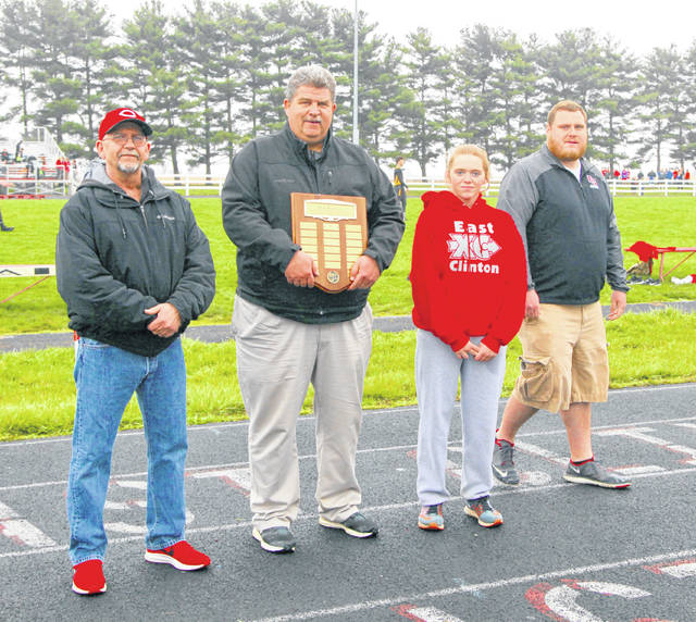 East Clinton's Alex Hughes was named the winner Tuesday of the Brett Wightman Award. The award, presented by Wightman's father Keith, is given to an East Clinton track and field athlete who shows leadership, character and dedication to the program. The presentation was made at the Brett Wightman Invitational at ECHS on Tuesday. In the photo, from left to right, Keith Wightman, East Clinton athletic director Jim Marsh, Hughes and East Clinton girls track and field coach Mike Fritz. Lance Cpl. Brett Wightman was killed in action in Iraq in 2005 while serving in the United States Marine Corps.