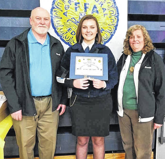 Two graduating seniors who are members of the Blanchester High School FFA chapter were each awarded a $500 scholarship from BDK Feed & Supply at an annual school FFA banquet. In this photo, FFA member Audrey Heitzman, center, receives her scholarship. She plans to pursue a course of study to become a large animal veterinarian. From left are BDK co-owner Darrell Kingsland, Heitzman, and BDK co-owner Brenda Kingsland.