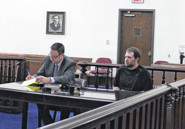 Bret Ledford, right, sits in Highland County Common Pleas Court on Tuesday during a sentencing hearing. Also shown is defense attorney Denny Kirk.