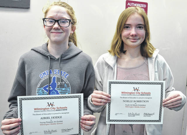 Two Wilmington Middle School students are recognized for their state-level artistic achievements. From left are Aeriel Hodge for Young People's Art Exhibit, and Noelle Robertson for Youth Art Month Exhibition.